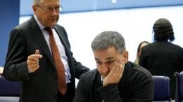 Managing Director of the European Stability Mechanism Klaus Regling (L) talks with Greek Finance Minister Eucleidis Tsakalotos (R). EPA/JULIEN WARNAND