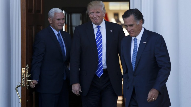 File PHOTO: Former Massachusetts Governor Mitt Romney (R) leaves after meeting with US President-elect Donald Trump (C) and Vice President-elect Mike Pence (L). EPA/Aude Guerrucci / POOL