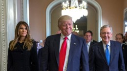 File PHOTO: President elect Donald Trump (C), with his wife Melania Trump (L), and Senate Majority Leader Mitch McConnell (R). EPA, SHAWN THEW
