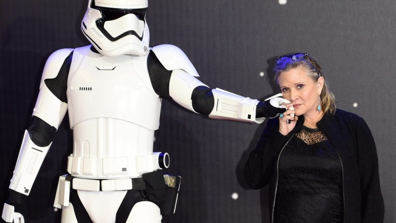 A file picture dated 16 December 2015 shows US actress/cast member Carrie Fisher posing next to a Stormtrooper film character as she arrives to the European premiere of the film 'Star Wars: The Force Awakens' in Leicester square in London, Britain. According to media reports on 23 December 2016, Carrie Fisher has been hospitalized due to a heart attack. EPA, FACUNDO ARRIZABALAGA