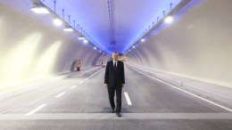A file picture provided by Turkish President Press office shows Turkish President Recep Tayyip Erdogan posing for a picture as he is crossing the Eurasia Tunnel.  EPA, TURKISH PRESIDENT PRESS OFFICE
