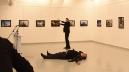 Gunman (C) stands near slain Russia's ambassador to Turkey, Andrey Karlov's body (down) after he shot him during an art exhibition in Ankara, Turkey, 19 December 2016. Russia's ambassador to Turkey, Andrey Karlov, has been shot at an art exhibition in the Turkish capital of Ankara. Karlov has died of his wounds after the attack, Russia's Ministry of Foreign Affairs confirmed. EPA/STR TURKEY OUT