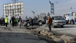 FILE PHOTO. Afghan security officials inspect the scene of a bomb blast. EPA/JAWAD JALALI