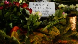 A note is placed among bunch of flowers to pay tribute to the victims at the site of the lorry attack in Berlin, Germany, 20 December 2016. At least 12 people were killed and dozens injured when a truck on 19 December drove into the Christmas market at Breitscheidplatz in Berlin, in what authorities believe was a deliberate attack. EPA/MAURIZIO GAMBARINI