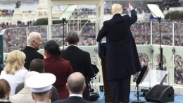 New US President Donald J. Trump (R) flashes a thumb-up gesture to the crowd during his inauguration as the 45th President of the United States at the US Capitol in Washington, DC, USA, 20 January 2017. Trump won the 08 November 2016 election to become the next US President. Looking on are former Vice President Joe Biden (L) and former US President Barack Obama (2-L). EPA, SAUL LOEB / POOL