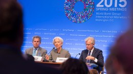 International Monetary Fund Managing Director Christine Lagarde (C), First Deputy Managing Director David Lipton and Communications Director Gerry Rice (R) hold a press conference at the IMF Headquarters in Washington, DC. IMF Staff Photo, Stephen Jaffe