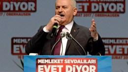 Turkish Prime Minister Binali Yildirim delivers a speech. EPA/SASCHA STEINBACH