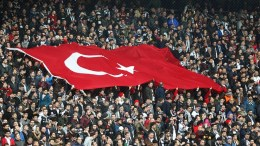 Besiktas fans hold a giant Turkish flag during the UEFA Europa League round of 16, second leg soccer match between Besiktas Istanbul and Olympiacos Piraeus in Istanbul, Turkey, 16 March 2017. EPA, TOLGA BOZOGLU