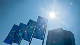 A file picture  of EU flags waving outside the European Central Bank (ECB) in Frankfurt, Germany. EPA/BORIS ROESSLER