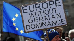 A man holds a placard reading 'Europe without German Dominance' during the 'March for Europe' rally in Berlin, Germany, 25 March 2017. Hundreds of participants joined the event on the 60th anniversary of the Treaty of Rome that marked the origin of the European Union. EPA, FELIPE TRUEBA