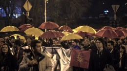 "Supporters of the Civil Initiative for United ""Macedonia"" hold yellow and red umbrellas (color of the Fyromian flag) and shout slogans during the protest march through the Skopje's streets in Skopje, the FYROM. EPA, GEORGI LICOVSKI"