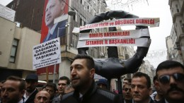 Protesters shout slogans and hold a banner reading 'Netherlands Don't mess with us' during the protest in front of the Netherlands Consulate on Istiklal street in Istanbul, Turkey, 11 March 2017. The Turkish Minister of Foreign Affairs Mevlut Cavusoglu had planned a speech in the Turkish Consul's residence in Hillegersberg, Rotterdam, but his flight to the Netherlands was cancelled. EPA, DENIZ TOPRAK