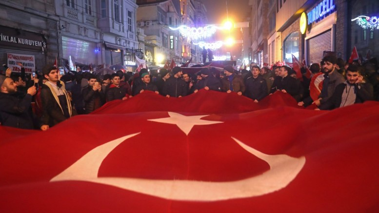 Supporters of Turkish President Recep Tayyip Erdogan shout slogans against Netherlands and hold Turkish flags in front of Netherlands' consulate in Istanbul. EPA/SEDAT SUNA