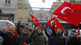 Supporters of Turkish President Recep Tayyip Erdogan shout slogans against the Netherlands in front of the Dutch Consulate in Istanbul, Turkey. FILE PHOTO. EPA/CEM TURKEL