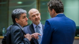 FILE PHOTO. Greek Finance Minister Euclid Tsakalotos (L) and European Commissioner in charge of Economic and Financial Affairs, Pierre Moscovici (C) and President of Eurogroup, Dutch Finance Minister, Jeroen Dijsselbloem (R) prior to the start of a Eurogroup Finance Ministers' meeting at the European Council headquarters in Brussels, Belgium. EPA, STEPHANIE LECOCQ
