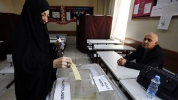 A veiled woman casts her vote at a polling station for a referendum on the constitutional reform in Istanbul. EPA, CEM TURKEL
