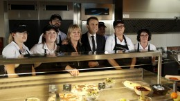 French presidential election candidate for the 'En Marche!' (Onwards!) political movement, Emmanuel Macron (C) poses for photographs with staff of a restaurant along the freeway which he visited on his way back to Paris, after voting in Le Touquet in the first round of the French presidential elections near Le Touquet-Paris-Plage, northern France, 23 April 2017. EPA, YOAN VALAT