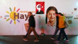 People walk past a banner reading 'Vote No for my future' with a poster of Mustafa Kemal Ataturk, founder of modern Turkey, in Istanbul, Turkey, 12 April 2017. A referendum on the constitutional reform in Turkey will be held on 16 April. The reform, passed by Turkish parliament on 21 January, would change the country's parliamentarian system of governance into a presidential one, which the opposition denounced as giving more power to Turkish president Recep Tayyip Erdogan. EPA, CEM TURKEL