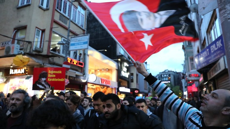 Protesters shout slogans and hold pictures of Mustafa Kemal Ataturk, founder of modern Turkey, reading on 'independence forms my character', during a rally against the referendum results in Istanbul, Turkey. EPA, TOLGA BOZOGLU