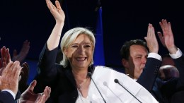 French presidential election candidate for the far-right Front National (FN) party, Marine Le Pen waves to supporters after the first round of the French presidential elections in Henin-Beaumont, Northern France. EPA/IAN LANGSDON