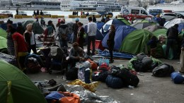 FILE PHOTO. Refugees from Syria and Iraq gather their belongings to move to a new organised hosting facility in Attica from the port of Piraeus, Greece. EPA/SIMELA PANTZARTZI