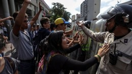 FILE PHOTO. Protesters clash in Caracas, Venezuela. Several protests broke out after a Supreme Court ruling took power from congress raising fear of a dictatorship. EPA/CRISTIAN HERNANDEZ