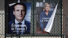 File Photo: Election posters of French presidential election candidate Emmanuel Macron (L) and Marine Le Pen (R) during the second round of the French presidential elections in Nice, France. EPA, SEBASTIEN NOGIER