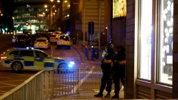 Armed officers patrol near the Manchester Arena following reports of an explosion, in Manchester, Britain, 23 May 2017. According to a statement released by the Greater Manchester Police on 23 May 2017, police responded to reports of an explosion at Manchester Arena on 22 May 2017 evening. At least 19 people have been confirmed dead and others 50 were injured, authorities said. The happening is currently treated as a terrorist incident until police know otherwise. EPA, NIGEL RODDIS