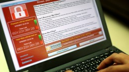 FILE PHOTO. A programer shows a sample of a ransomware cyberattack on a laptop. EPA, RITCHIE B. TONGO