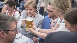 Germany's Christian Democratic Union (CDU) party chairwoman and German Chancellor Angela Merkel receives a glass of beer during an election campaign event of the German Christian Social Union (CSU) party at the 46th Truderinger Festwoche festival week in Munich, Bavaria, Germany, 28 May 2017. EPA, CHRISTIAN BRUNA