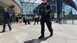 Armed police on patrol in Britain. EPA/ANDY RAIN