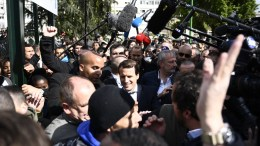 French presidential election candidate for the En Marche! movement Emmanuel Macron greets people during a campaign visit to Sarcelles, north of Paris, France. The second turn of the French elections happens on 07 May 2017. EPA/MARTIN BUREAU/POOL MAXPPP OUT