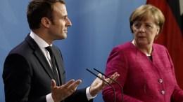 FILE PHOTO. German Chancellor Angela Merkel (R) and French President Emmanuel Macron (L)  EPA, CARSTEN KOALL