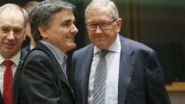 File Photo: Greek Finance Minister Euclid Tsakalotos (C) and the Chief Executive Officer of the European Financial Stability Facility (EFSF) and Managing Director of the European Stability Mechanism, Klaus Regling (R), wait for the start of a Eurogroup Finance Ministers' meeting at the European Council headquarters in Brussels, Belgium. EPA, OLIVIER HOSLET