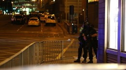 Armed officers patrol near the Manchester Arena following reports of an explosion, in Manchester, Britain, 23 May 2017. According to a statement released by the Greater Manchester Police on 23 May 2017, police responded to reports of an explosion at Manchester Arena on 22 May 2017 evening. At least 19 people have been confirmed dead and others 50 were injured, authorities said. The happening is currently treated as a terrorist incident until police know otherwise. According to reports quoting witnesses, a mass evacuation was prompted after explosions were heard at the end of US singer Ariana Grande's concert in the arena.  EPA/NIGEL RODDIS