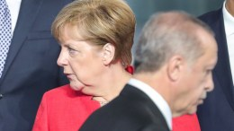 FILE PHOTO. German Chancellor Angela Merkel (L) looks on as Turkish President Recep Tayyip Erdogan (R) walks by, during a line up for the group photo at the NATO summit in Brussels, Belgium. EPA, ARMANDO BABANI