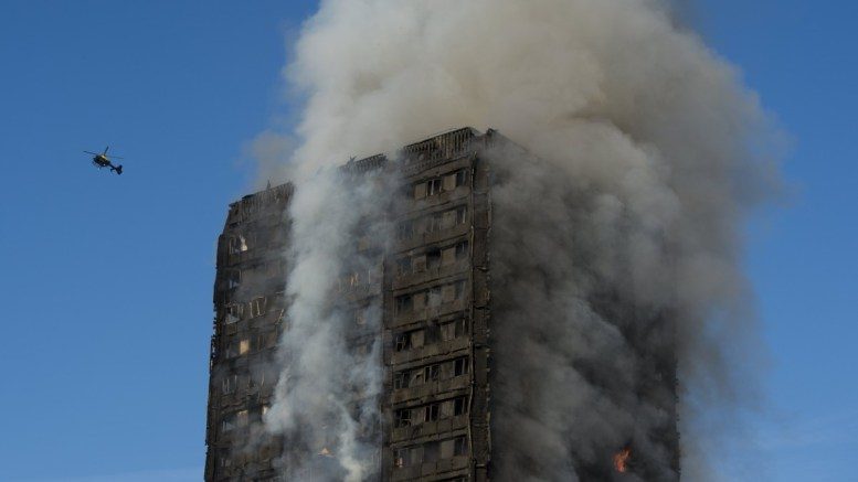 FILE PHOTO. Smoke rises from the fire at the Grenfell Tower, a 24-storey apartment block in North Kensington, London. EPA/WILL OLIVER