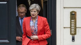 FILE PHOTO. British Prime Minister Theresa May and her husband Philip leave the Conservative headquarters in central London. EPA/FACUNDO ARRIZABALAGA