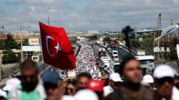 FILE PHOTO. Supporters of Turkey's main opposition Republican People's Party (CHP) holds Turkish flag during a march from Ankara to Istanbul to call attention to arrests by Turkish courts, in Kocaeli, Turkey. EPA/SEDAT SUNA