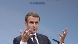 FILE PHOTO: French President Emmanuel Macron gestures while speaking at a press conference at the end of the G20 summit in Hamburg, Germany. EPA, IAN LANGSDON