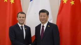 French President Emmanuel Macron shakes hands with Chinese President Xi Jinping during a bilateral meeting on the second day of the G20 summit in Hamburg, Germany. EPA/IAN LANGSDON / POOL.