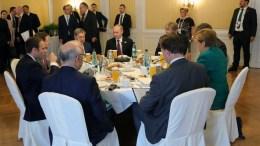 (Seated at the table) French President Emmanuel Macron (L) Russian President Vladimir Putin (back C), German Chancellor Angela Merkel (R) and other G20 summit participants attend a working breakfast on the sidelines of the G20 summit in Hamburg, Germany, 08 July 2017. EPA/MICHAEL KLIMENTYEV / SPUTNIK / KREMLIN POOL MANDATORY CREDIT