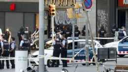 File Photo: Police officers and emergency service workers set up a security perimeter near the site where a van crashes into pedestrians in Las Ramblas, downtown Barcelona, northeastern Spain, 17 August 2017. Andreu Dalmau. EPA, FACES FACES PIXELATED BY SOURCE DUE TO SPANISH LAW