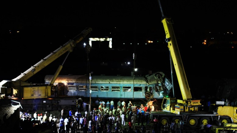 Egyptian workers and security personnel prepare to retrieve the wreckage left by the collision of two passenger trains in Alexandria, Egypt, 11 August 2017. EPA, HAZEM GOUDA