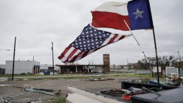 FILE PHOTO. US and Texas flags fly in the aftermath of Hurricane Harvey. EPA/DARREN ABATE