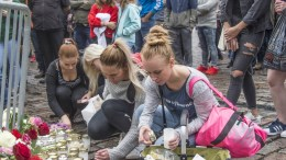 People place candles and flowers on the Market Place in Turku, Finland, 19 August 2017 following the fatal attack the folowing evening. According to police reports on 19 August, two people were killed and eight people injured in a stabbing spree the police now defines as a terrorist act on two market squares in Turku, 18 August 2017. Finnish police shot and injured the attacks and has made more arrests during the night. EPA/MARKKU OJALA