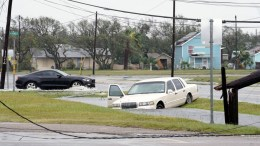 FILE PHOTO. A motorist drives past a car caught in flood water in the aftermath of Hurricane Harvey in Rockport, Texas, USA, 26 August 2017. Hurricane Harvey made landfall on the south coast of Texas as a major hurricane category 4, and was the worst storm to hit the city of Rockport in 47 years. The last time a major hurricane of this size hit the United States was in 2005. EPA/DARREN ABATE