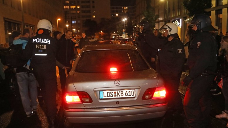 FILE PHOTO: Police officers protect a vehicle with an AFD politician, as it leaves the night club where right-wing populist party AfD holds their election event in Berlin, Germany, 24 September 2017. EPA, FOCKE STRANGMANN