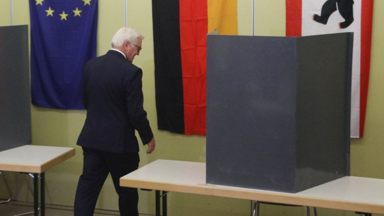 German President Frank-Walter Steinmeier enters the voting cabin during the federal elections in Germany at a polling station in Berlin, Germany, 24 September 2017. According to federal election commissioner more than 61 million people are eligible to vote in the elections for a new federal parliament, the Bundestag, in Germany. EPA, FOCKE STRANGMANN