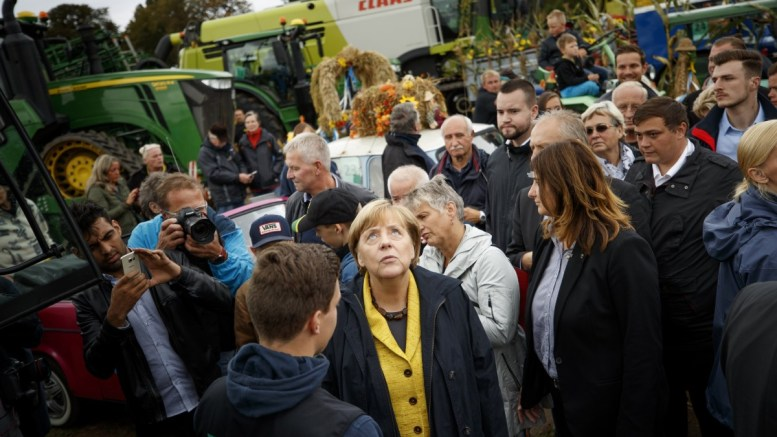 German Chancellor Angela Merkel (C), the leader of the German Christian Democratic Union (CDU) and top candidate for the general election, visits the tractor exhibition during an election campaign tour to a Thanksgiving funfair in Lauenburg part of Putbus in Mecklenburg-Western Pomerania, Germany, 23 September 2017. Angela Merkel is on election campaign tour for the general elections which are scheduled to be held on 24 September 2017. EPA, CARSTEN KOALL